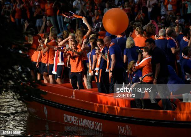 The Dutch player's football women team celebrate the victory on a boat in Utrecht on August 7 2017 after Dutch women players's won the UEFA Women's...