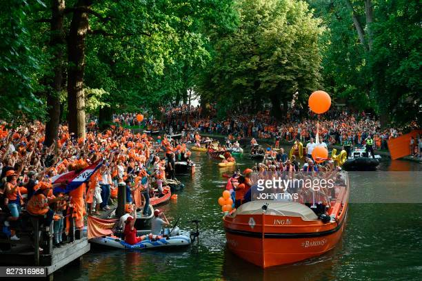 TOPSHOT The Dutch player's football women team celebrate the victory on a boat in Utrecht on August 7 2017 after Dutch women players's won the UEFA...