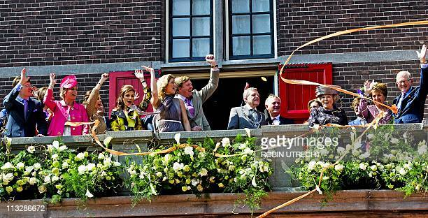 The Dutch royal family waves to the crowd during Queensday celebrations in Weert on April 30 2011 AFP PHOTO/ANP/ROYAL IMAGES/ROBIN UTRECHT...