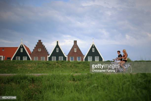 The Dutch try to continue with daily life as people cycle through the traditional Dutch town of Volendam and the Netherlands tries to come to terms...
