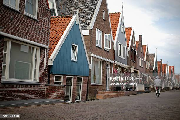 The Dutch try to continue with daily life as people cycle through the traditional Dutch town of Volendam as the Netherlands tries to come to terms...
