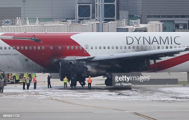 The Dynamic International Airways Boeing 767 that caught fire sits on the runway at Fort LauderdaleHollywood International Airport on October 29 2015...
