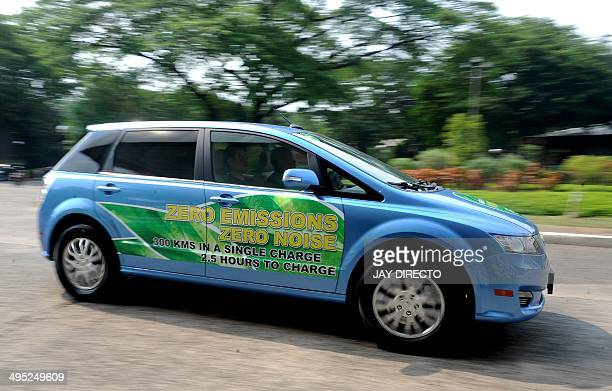 The 'e6' by auto maker BYD a pure electric car is introduced to lawmakers at the Philippines' House of Representatives in Manila as an alternative...