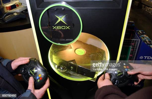 The eagerly awaited Microsoft XBOX games console on display at HMV's Oxford Street store in London's West End The games console was delivered to the...