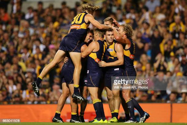 The Eagles celebrates after scoring a goal during the round two AFL match between the West Coast Eagles and the St Kilda Saints at Domain Stadium on...