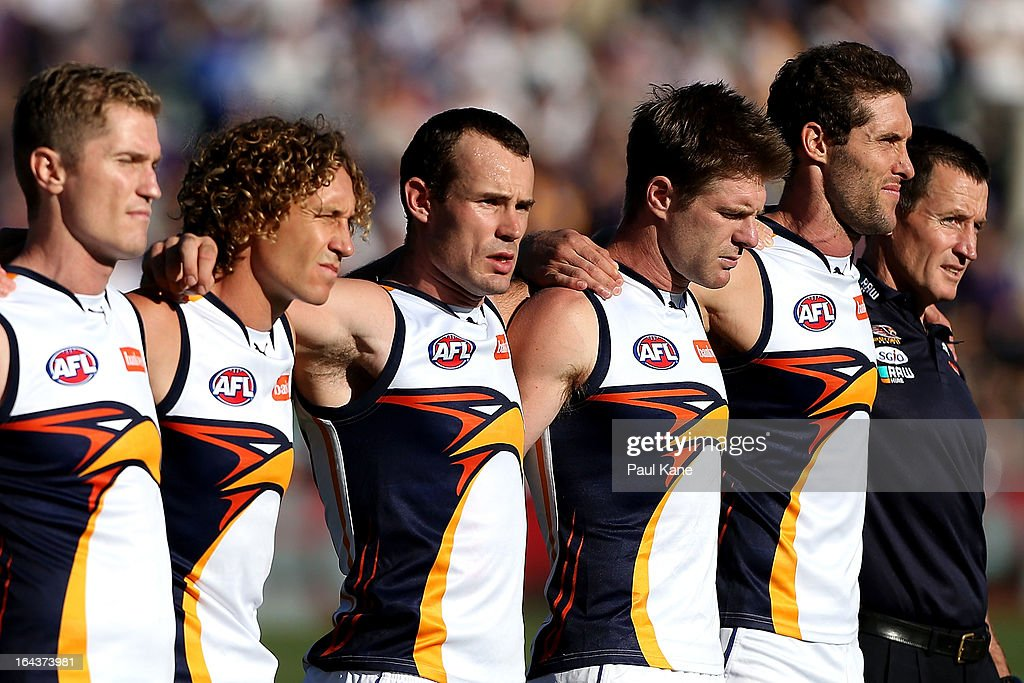 The Eagles line up for the Australian national anthem during the round one AFL match between the Fremantle Dockers and the West Coast Eagles at Patersons Stadium on March 23, 2013 in Perth, Australia.