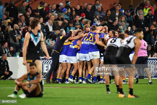 The Eagles players celebrate after the final siren during the AFL First Elimination Final match between Port Adelaide Power and West Coast Eagles at...
