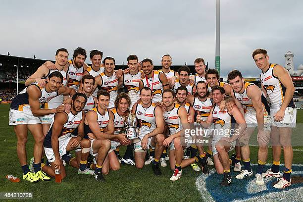 The Eagles pose with the Western Derby trophy after winning the round 20 AFL match between the Fremantle Dockers and the West Coast Eagles at Domain...