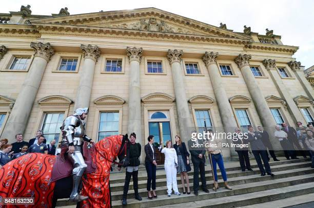 The Earl and Countess of Harewood and Princess Beatrice welcome torch bearer Janet Baker and the Olympic Flame on the steps of Harewood House near...