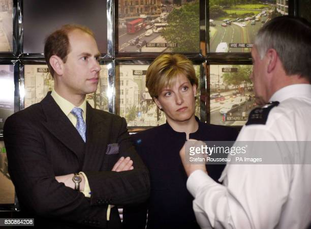 The Earl and Countess of Wessex stand in front of TV monitors as they tour the control room at Scotland Yard in central London where they saw the...