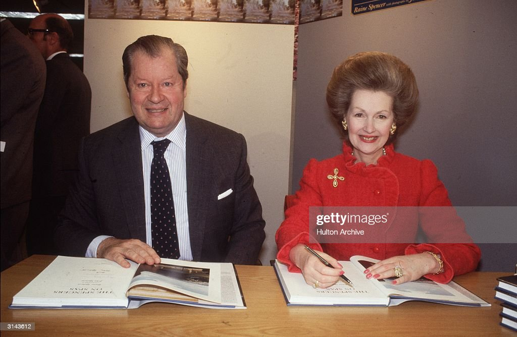 The Earl (1924 - 1992) and Countess Spencer (father and stepmother of Diana, Princess of Wales) autographing their book,' The Spencers on Spas'.