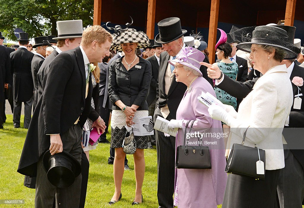 The Earl of Derby, son Edward Stanley, The Countess of Derby and Lady Henrietta Stanley meet Queen Elizabeth II at Derby Day at the Investec Derby Festival at Epsom Downs Racecourse on June 6, 2014 in Epsom, England.