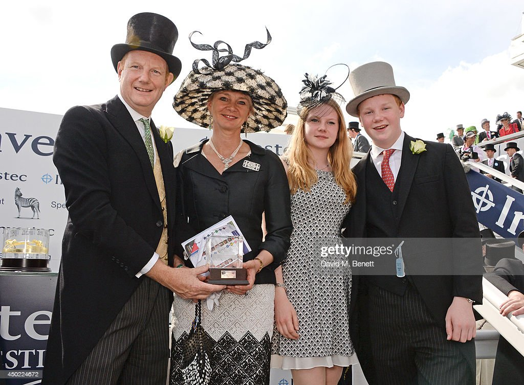The Earl of Derby, the Countess of Derby, Lady Henrietta Stanley and Edward Stanley celebrate Australia's win of the Investec Derby during Derby Day at the Investec Derby Festival at Epsom Downs Racecourse on June 6, 2014 in Epsom, England.