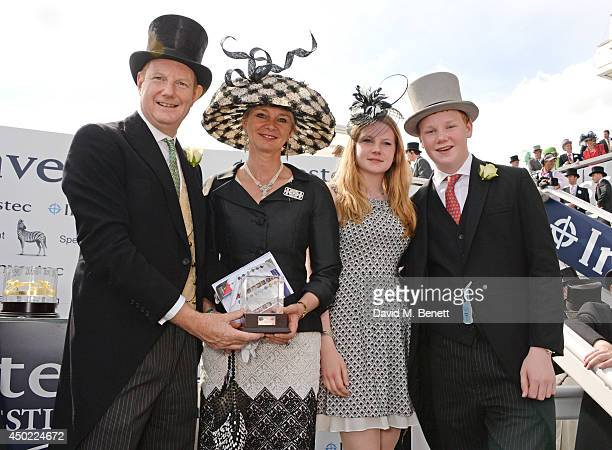 The Earl of Derby the Countess of Derby Lady Henrietta Stanley and Edward Stanley celebrate Australia's win of the Investec Derby during Derby Day at...