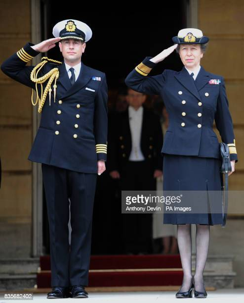 The Earl of Wessex and the Princess Royal salute as the national anthem is played during a Royal Garden Party at Buckingham Palace in central London...