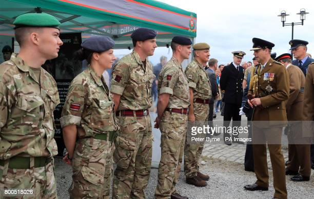 The Earl of Wessex speaks to members of the armed forces during the ninth annual Armed Forces Day in Liverpool