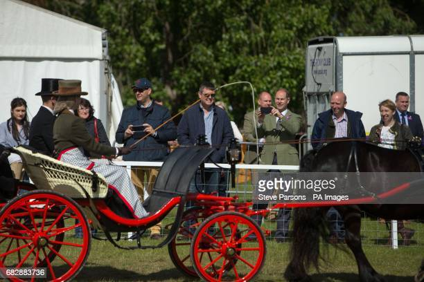 The Earl of Wessex takes a picture of his daughter Lady Louise Windsor leading the Champagne LaurentPerrier Meet of the British Driving Society at...