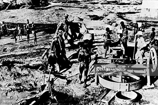 The early days of the Kimberley mine in 1871 in Kimberley South Africa The image shows the first mining machines and the exploitation of the local...