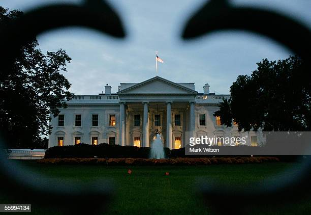 The early morning sun begins to rise behind the White House October 24 2005 in Washington DC This week Federal prosecutor Patrick Fitzgerald may...