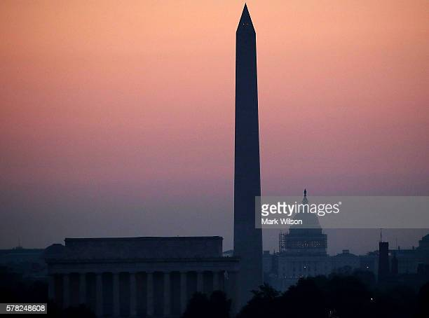 The early morning sun begins to rise over the US Capitol Washington Monument and Lincoln Memorial on July 21 2016 in Washington DC Washington area...
