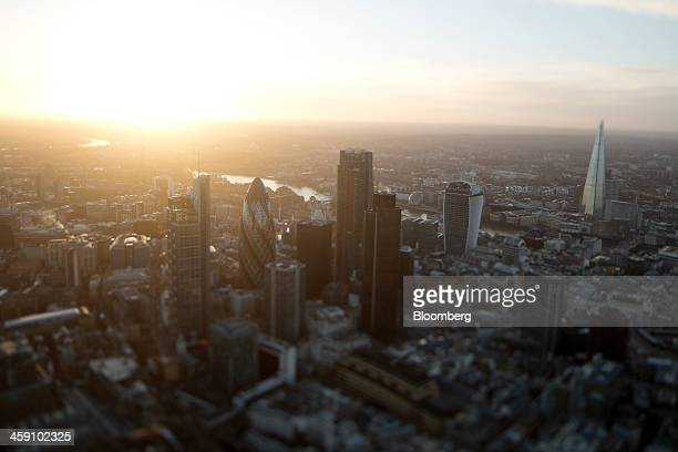 The early morning sun rises beyond skyscrapers including Tower 42 the Heron Tower the Leadenhall building also known as the 'Cheesegrater' 30 St Mary...