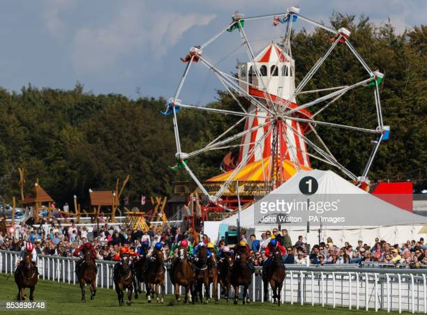 The early stages of The Doom Bar Maiden Fillies' Stakes as Flashy Diva ridden by Jason Doyle goes on to win at Goodwood Racecourse Chichester