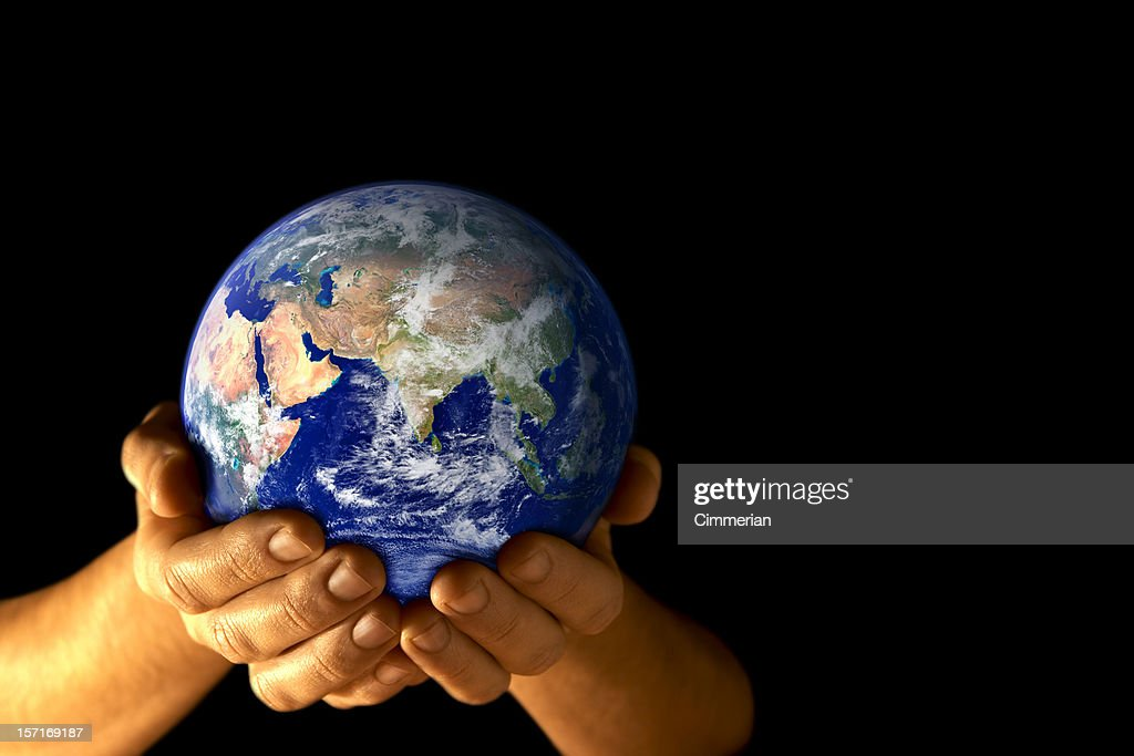 The Earth held in cupped hands with a view of Asia : Stock Photo