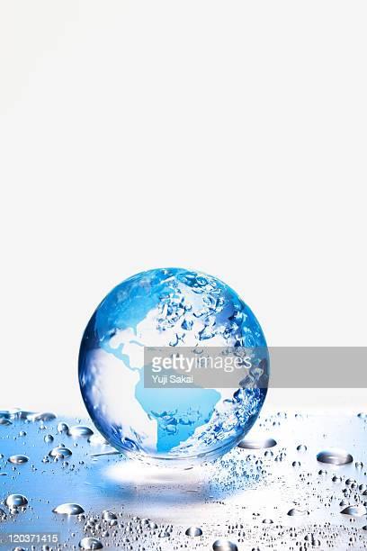 the earth  on metal board