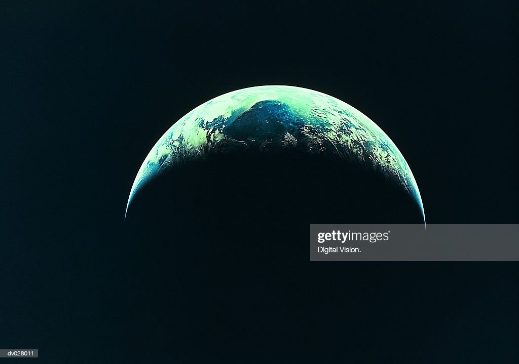 The Earth, partly illuminated