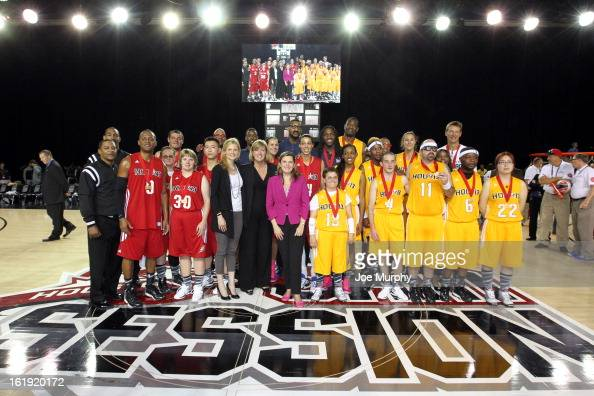 The East and West teams pose for a photo after the NBA Cares Special Olympics Unity Sports Basketball Game on Center Court during the 2013 NBA Jam...