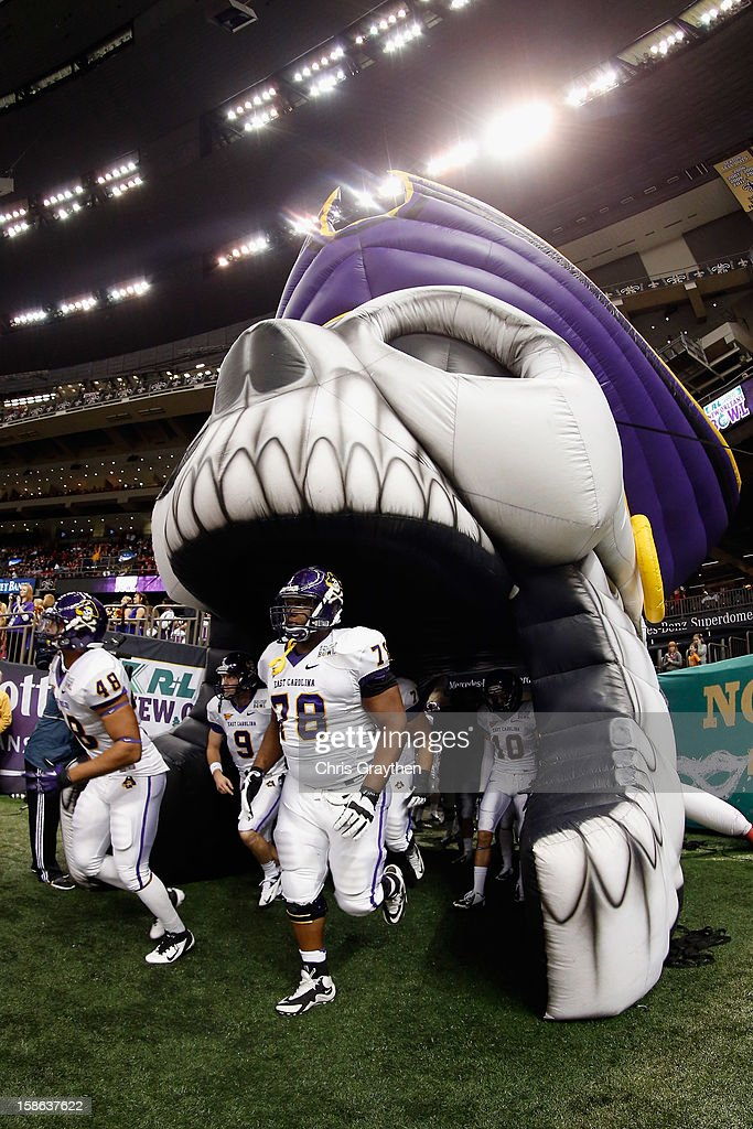The East Carolina Pirates take the field during the R+L Carriers New Orleans Bow at the Mercedes-Benz Superdome on December 22, 2012 in New Orleans, Louisiana.