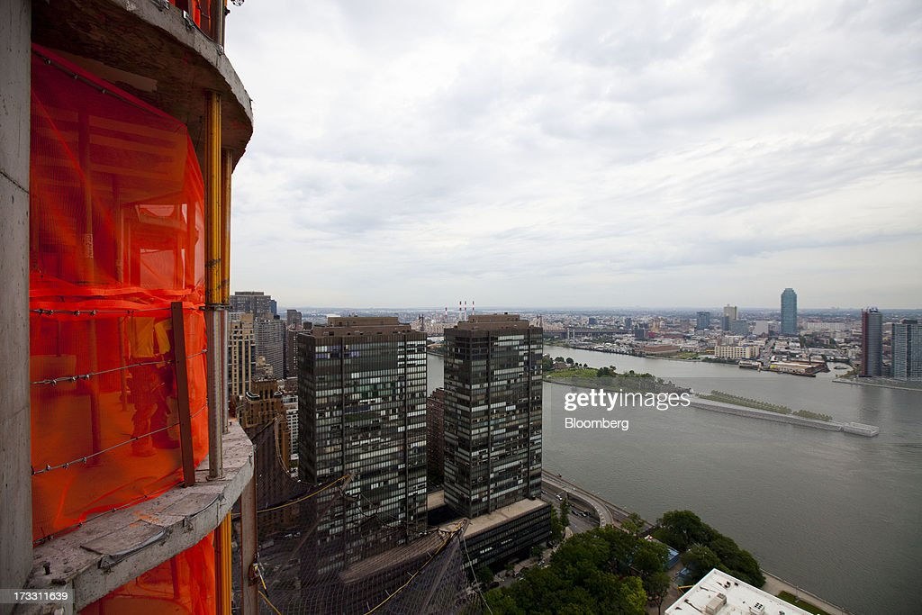 The East River is seen from the 34th floor at 50 UN Plaza in New York, U.S., on Thursday, July 11, 2013. Located across the street from the United Nations, 50 UN Plaza, Arthur and William Lie Zeckendorf's latest Manhattan luxury-condominium project is a 44-story tower that will be the Turtle Bay neighborhood's first new residential project in a dozen years. Photographer: Jin Lee/Bloomberg via Getty Images