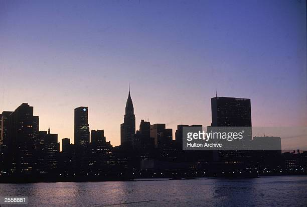 The east side of the New York City skyline at dusk circa 1970