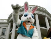 The Easter Bunny attends the annual Easter Egg Roll on the South Lawn that attracted several hundred children in the rain at the White House 12 April...