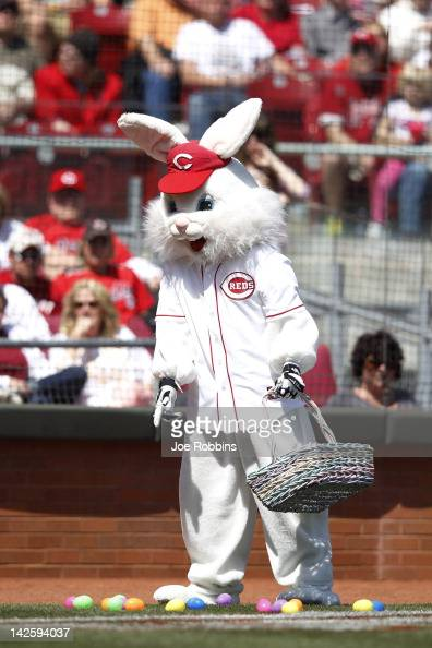 The Easter Bunny drops eggs on the field in between innings of the game between the Cincinnati Reds and Miami Marlins at Great American Ball Park on...