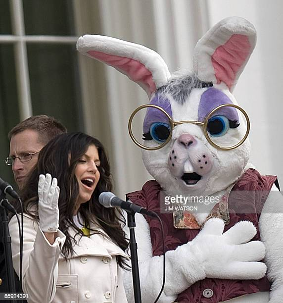The Easter Bunny holds his paw over his heart as music pop star Fergie sings the US National Anthem at the 2009 White House Easter Egg Roll on the...