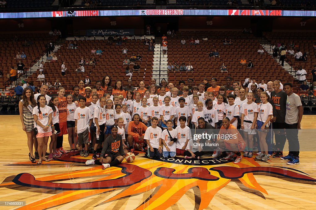The Eastern and Western Conference All-Stars pose with students from Sandy Hook Elementary school during the 2013 Boost Mobile WNBA All-Star Game on July 27, 2013 at Mohegan Sun Arena in Uncasville, Connecticut.