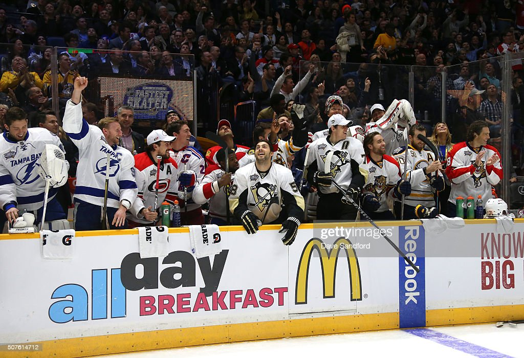 The Eastern Conference bench react after Dylan Larkin of the Detroit Red Wings won the Bridgestone NHL Fastest Skater with a time of 12894 seconds...