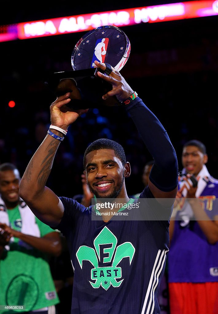 The Eastern Conference's Kyrie Irving #2 of the Cleveland Cavaliers celebrates with the Kia NBA All-Star Game MVP trophy after the 2014 NBA All-Star game at the Smoothie King Center on February 16, 2014 in New Orleans, Louisiana.