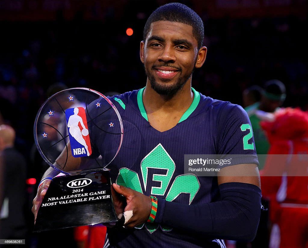 The Eastern Conference's <a gi-track='captionPersonalityLinkClicked' href=/galleries/search?phrase=Kyrie+Irving&family=editorial&specificpeople=6893971 ng-click='$event.stopPropagation()'>Kyrie Irving</a> #2 of the Cleveland Cavaliers celebrates with the Kia NBA All-Star Game MVP trophy after the 2014 NBA All-Star game at the Smoothie King Center on February 16, 2014 in New Orleans, Louisiana.