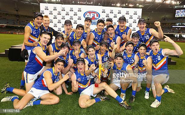 The Eastern Ranges celebrate with the Premiership Cup after winning the TAC Cup final match between Eastern Ranges and the Dandenong Southern...