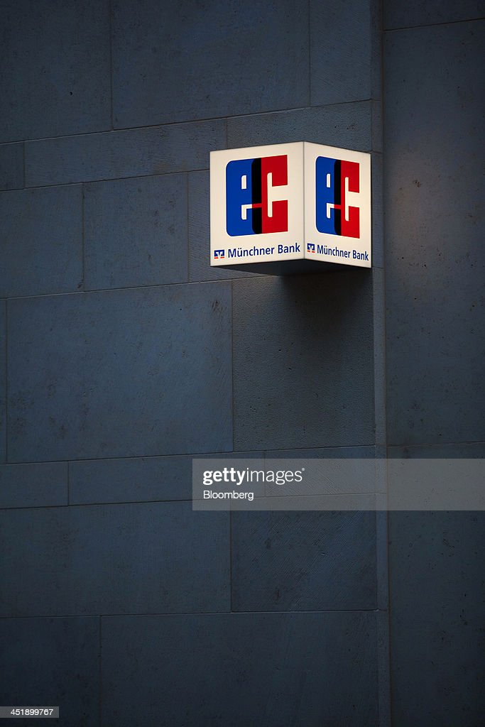 The EC symbol, a sign for the electronic cash debit system sits outside a branch of Munchner Bank eG in Munich, Germany, on Sunday, Nov. 24, 2013. In Germany, Europe's biggest economy, annual consumer prices increased 1.2 percent in October. Photographer: Krisztian Bocsi/Bloomberg via Getty Images