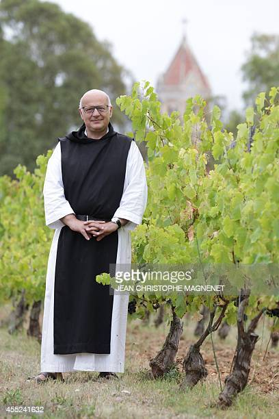 The economist monk 'Frère Marie' of 'Abbaye de Lerins' poses in a vineyard on Agust 26 at the Saint Honorat island in the bay of Cannes southeastern...