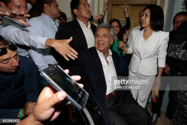 The Ecuadorean presidential candidate of the Alianza PAIS party Lenin Moreno accompanied by his wife Rocio Gonzalez arrives at a polling station in...