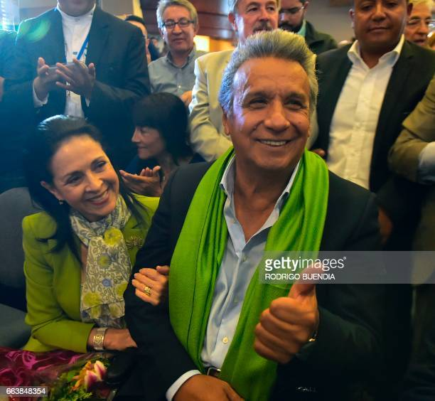 The Ecuadorean presidential candidate of the ruling Alianza PAIS party Lenin Moreno next to his wife Rocio Gonzalez listens to the first results of...