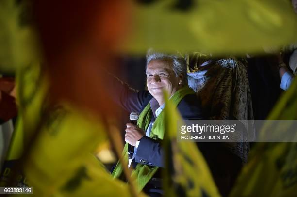 The Ecuadorean presidential candidate of the ruling Alianza PAIS party Lenin Moreno waves to his supporters as they wait for the final results of the...