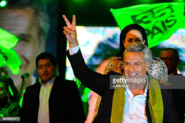 The Ecuadorean presidential candidate of the ruling Alianza PAIS party Lenin Moreno gives the 'V for victory' sign to his supporters as they wait for...