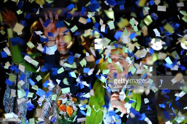 The Ecuadorean presidential candidate of the ruling Alianza PAIS party Lenin Moreno waves to his supporters after giving a speech while waiting for...