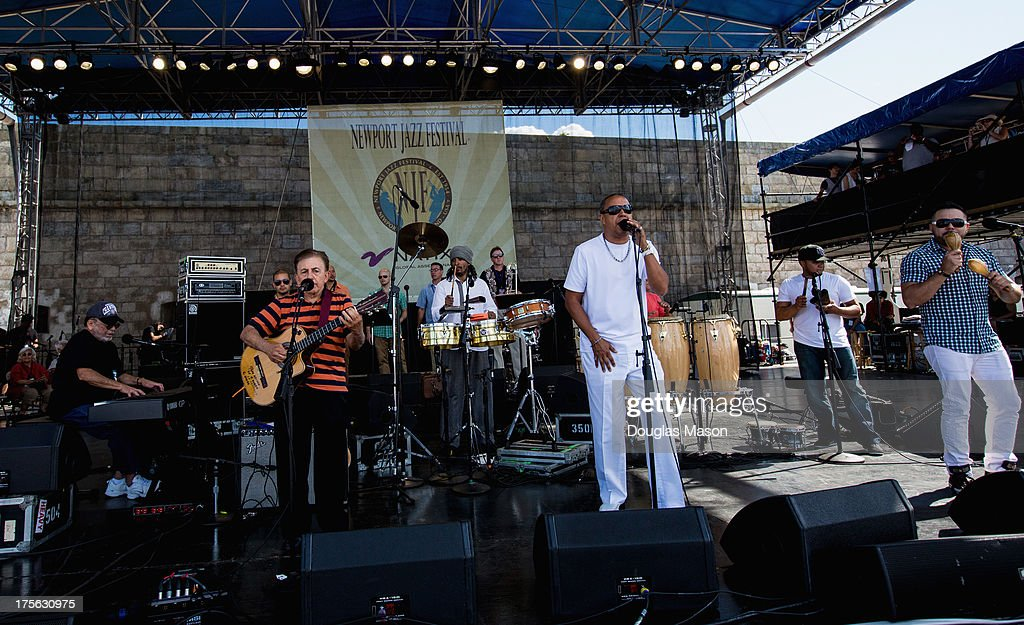 The Eddie Palmeri Salsa Orchestra (Eddie Palmeri, piano, Jose Claussell, timbales, Luques Curtis, bass, Vicente Rivero, congas, Orlando Vega, bongos, Herman Olivera, vocals, Nelson Gonzalez, tres, Joseph Gonzalez, vocals, Jonathan Powell, trumpet, John Walsh, trumpet, Conrad Herwig, trombone, Louis Fouche, alto sax, Jimmy Bosch, trombone) performs during the Newport Jazz Festival 2013 at Fort Adams State Park on August 4, 2013 in Newport, Rhode Island.