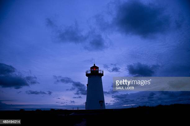 The Edgartown Lighthouse is seen at dawn on Martha's Vineyard in Edgartown Massachusetts August 9 2015 AFP PHOTO / SAUL LOEB